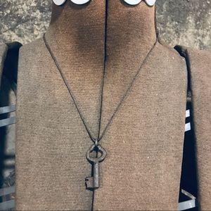 Vintage small skeleton key on twine necklace